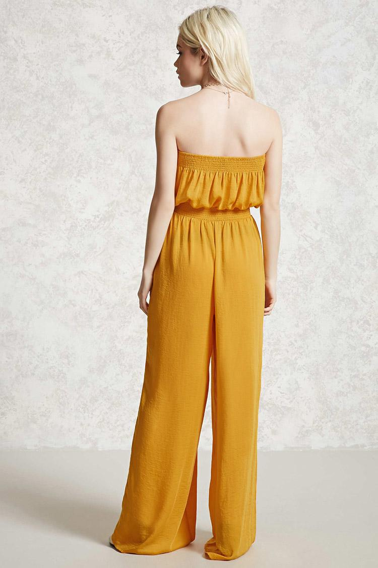 forever 21 strapless smocked jumpsuit in yellow lyst