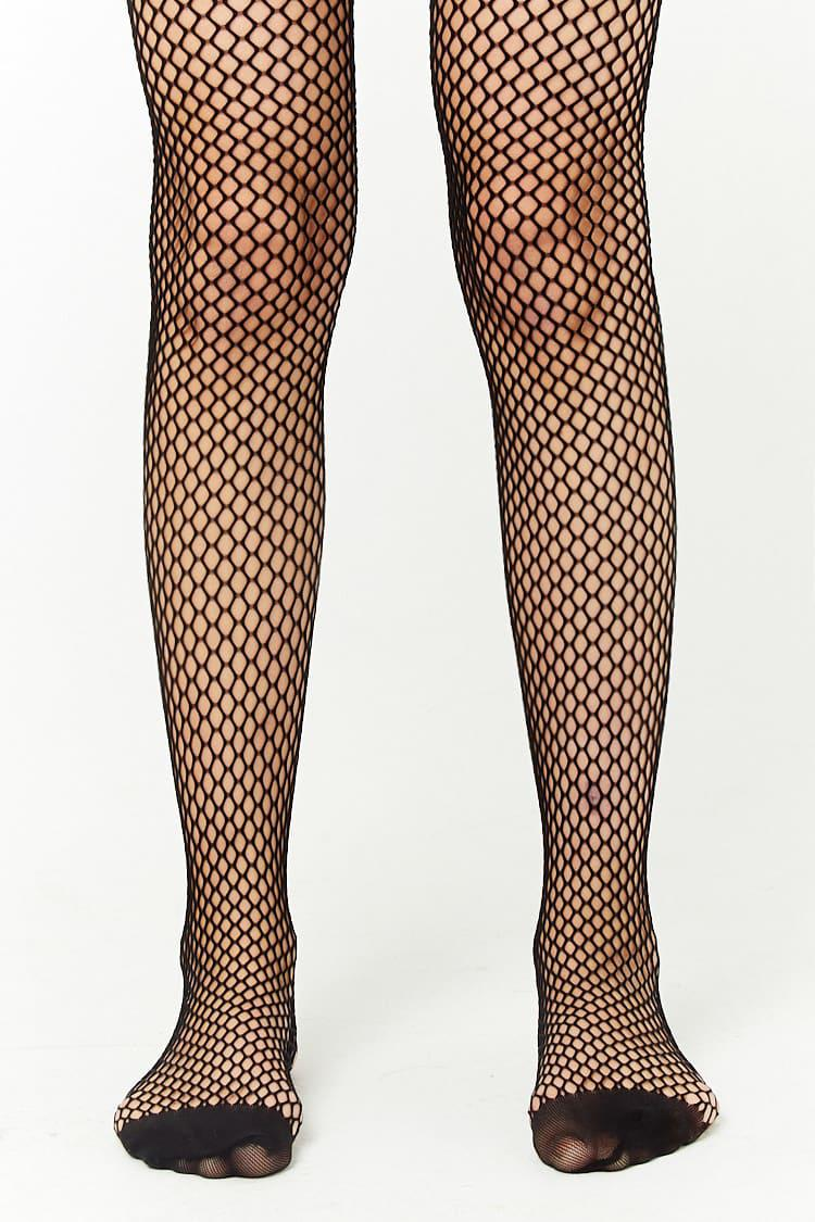 d4d05d7a43f79 Forever 21 - Black Sheer Fishnet Tights - Lyst. View fullscreen