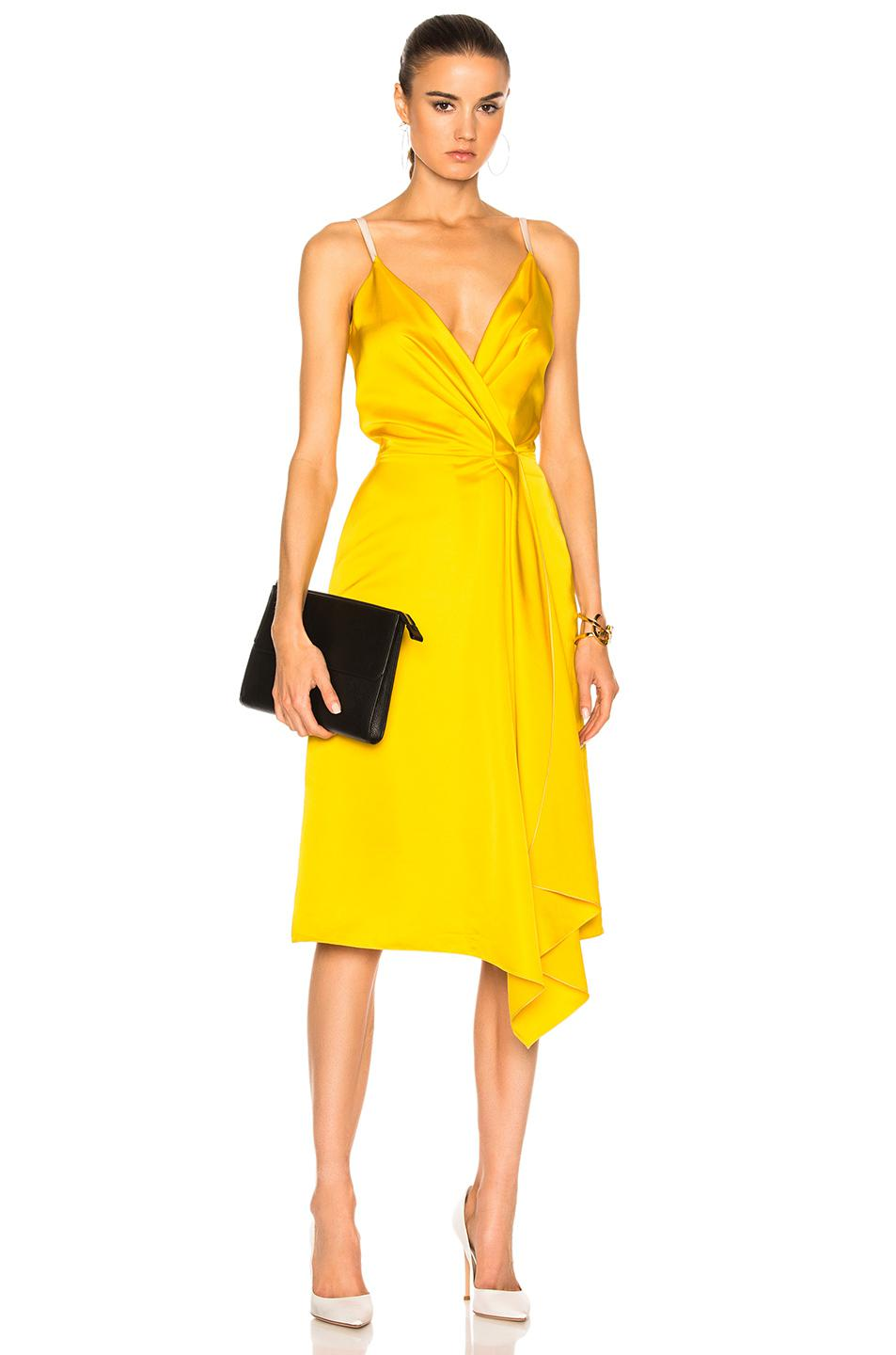4e42a23b2ca Victoria Beckham Heavy Fluid Silk Wrap Dress in Yellow - Lyst