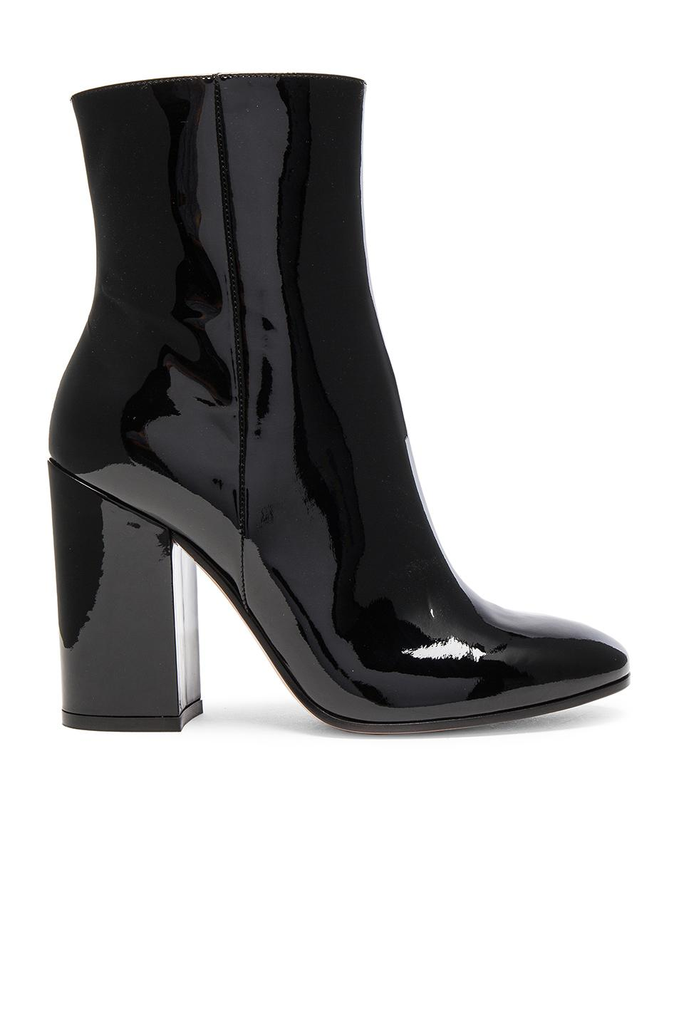 High heeled boot Side zipper closure Pointy toe design Slouchy patent leather upper Neoprene lining Padded leather insole Leather sole 3 inch block heel Made in Italy.