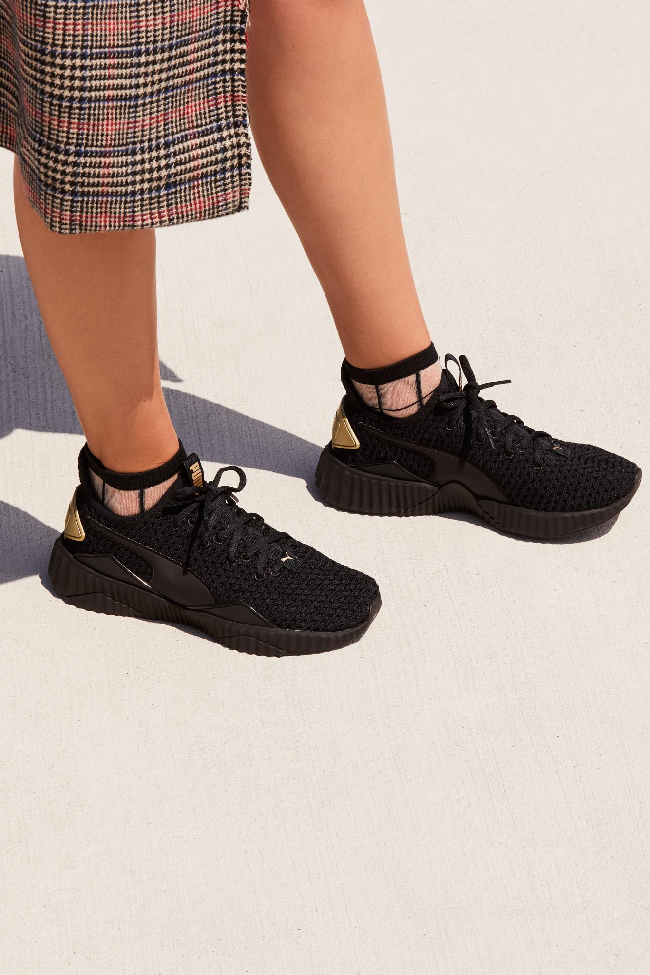 099c51f3452e Free People Defy Ns Trainer By Puma in Black - Lyst