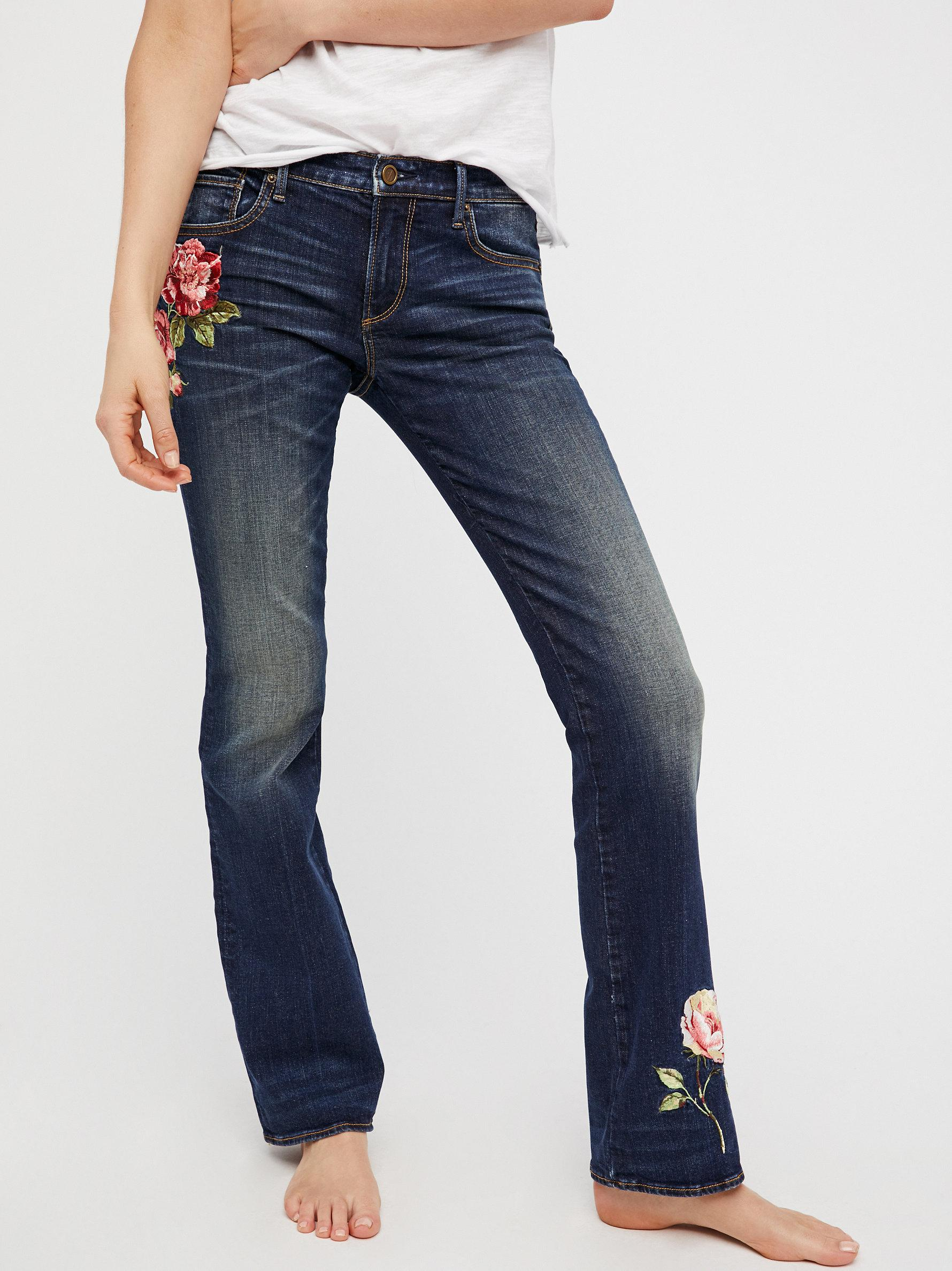 Lyst free people kelly embroidered baby bootcut jeans in