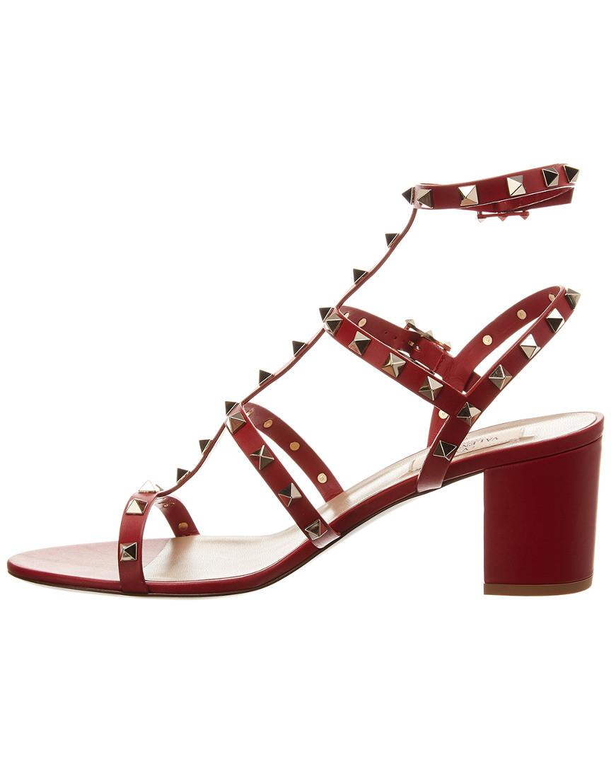 3f61a2fc23c5 Lyst - Valentino Rockstud Caged 60 Leather Sandal in Red