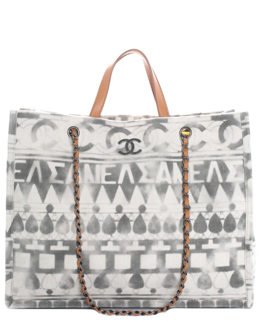 afaf37abb55d Lyst - Chanel 2018 Grey   White Canvas Large Iliad Deauville ...