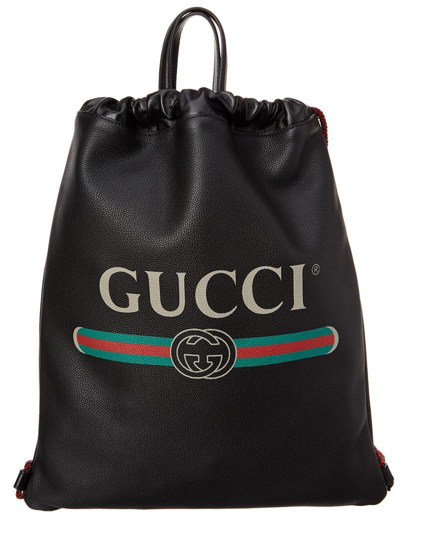06f7550bb07e Gucci - Black Logo Printed Leather Drawstring Backpack for Men - Lyst. View  fullscreen