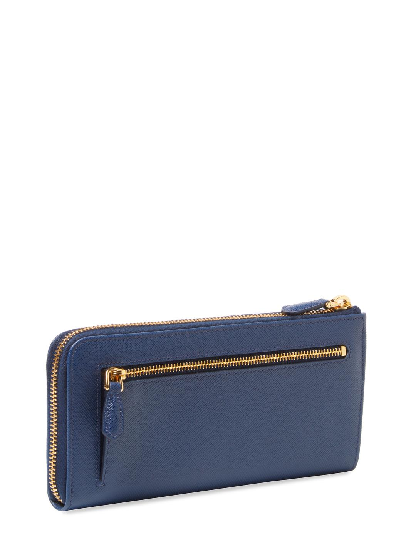 d3e1d882ba92 Lyst - Prada Saffiano Leather Half Zip Wallet in Blue