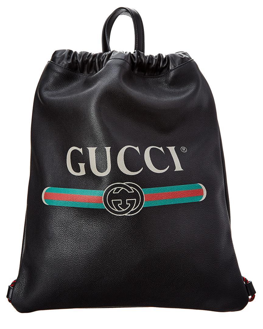 384da67b5302 Gucci - Black Vintage Logo Printed Drawstring Backpack for Men - Lyst. View  fullscreen