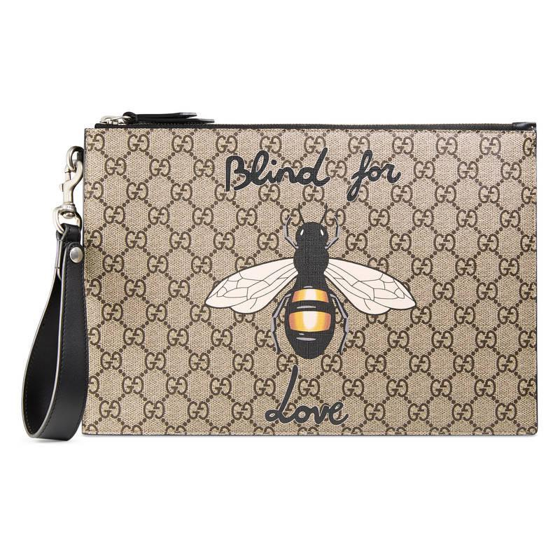 75793176bf8c Gucci Bee Print Gg Supreme Pouch in Natural - Lyst