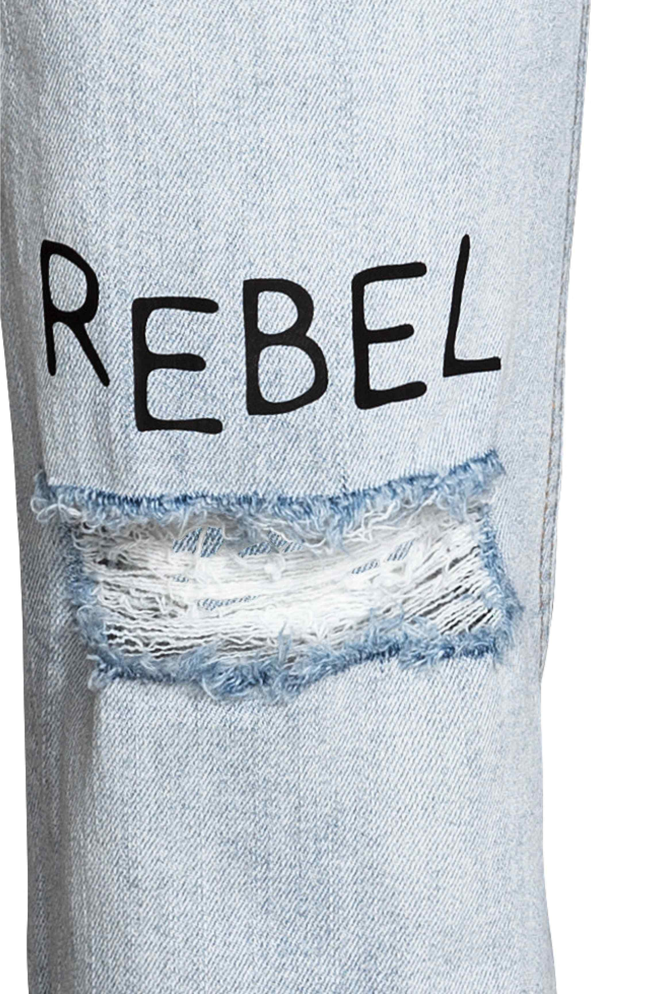 Glass bottle through ripped jeans