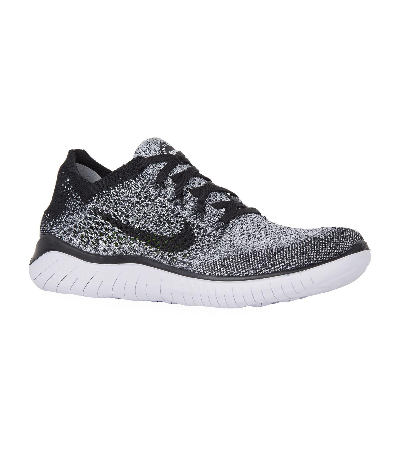 the latest 119fc 986d2 Nike - White Free Rn Flyknit Trainers - Lyst. View fullscreen