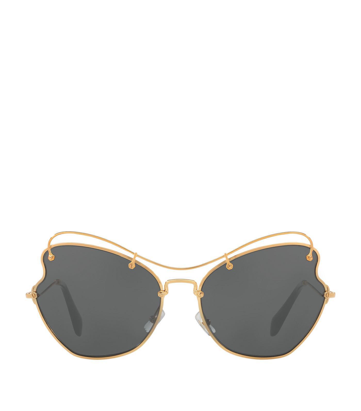 dc82fb96c016 Lyst - Miu Miu Metal Irregular Sunglasses in Metallic