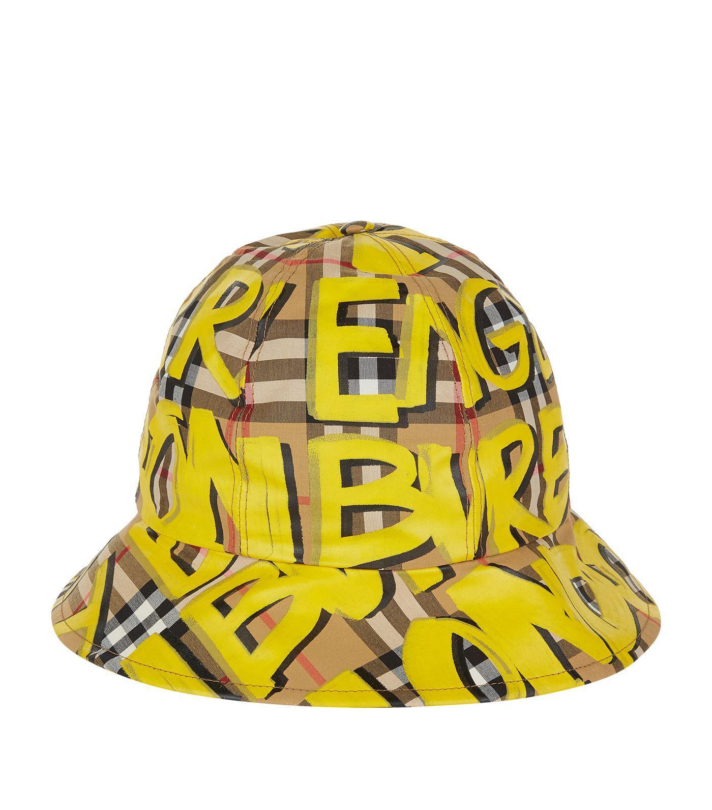 ddd3e532632 Lyst - Burberry Graffiti Check Bucket Hat in Yellow