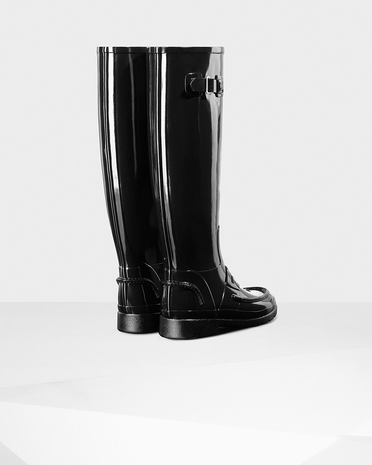 4b3e77c618f Lyst - HUNTER Women s Original Refined Penny Loafer Tall Boots in Black