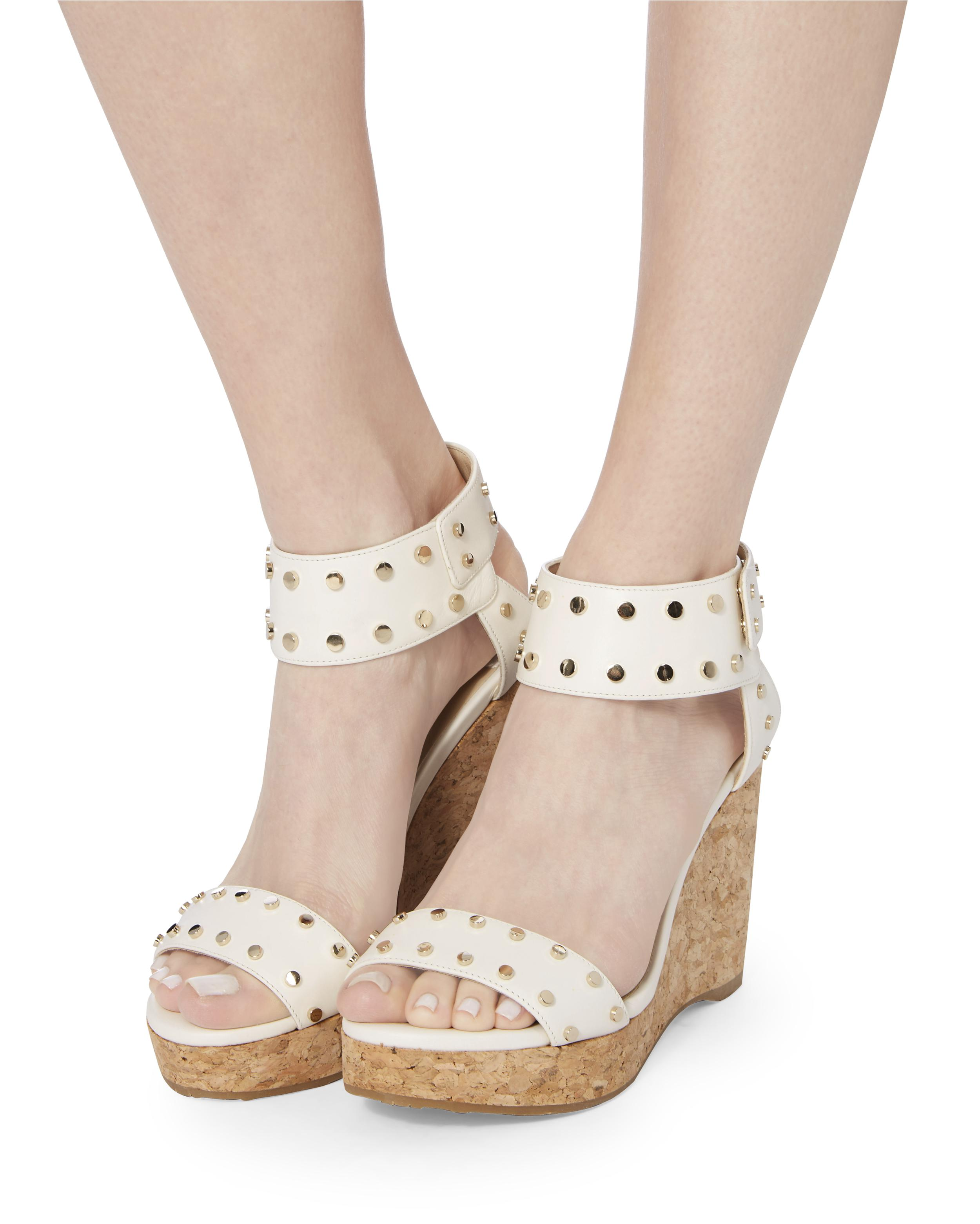 8378651b3faa Lyst - Jimmy Choo Nelly Leather Wedge Sandals in White