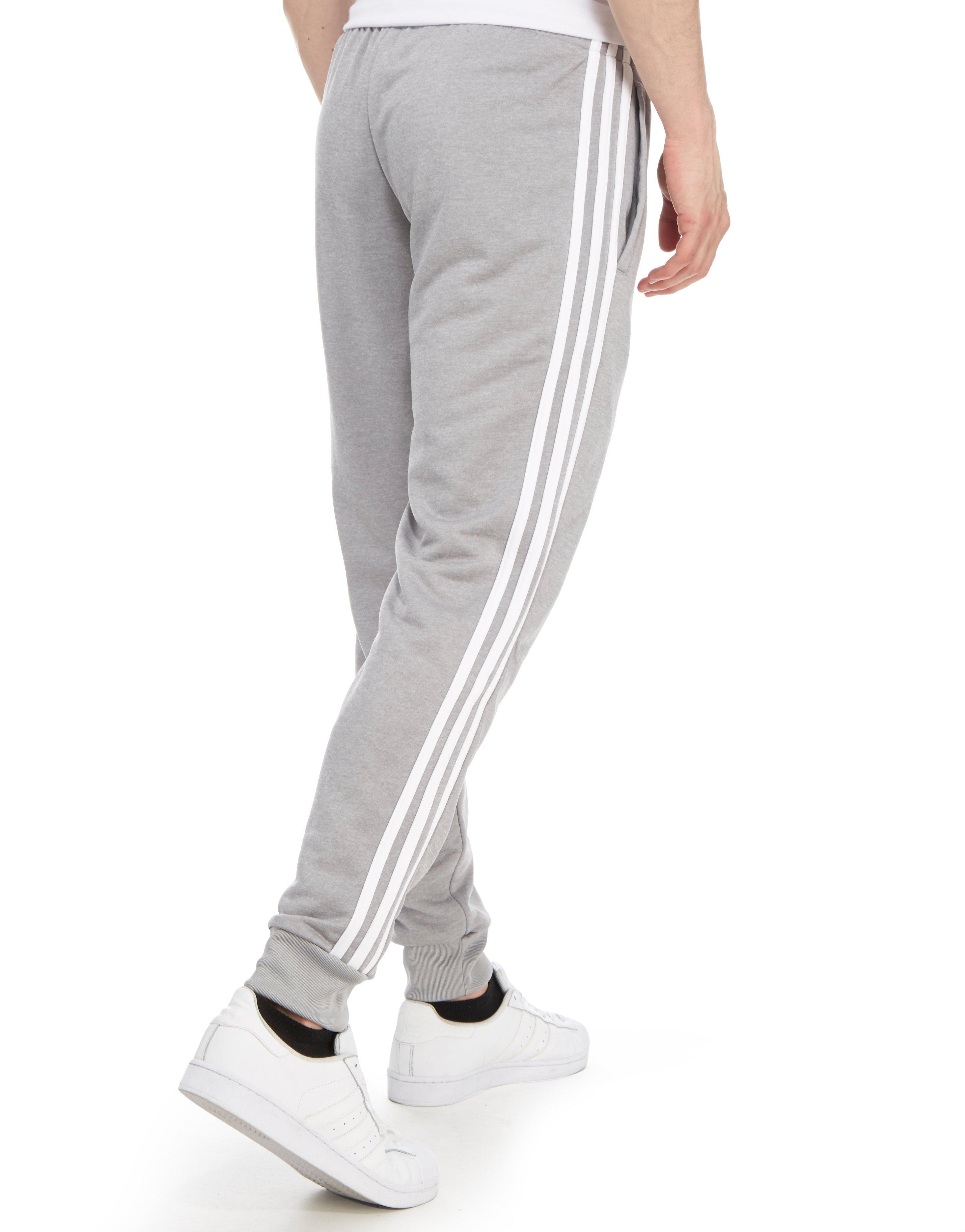 adidas originals superstar poly track pants in gray for