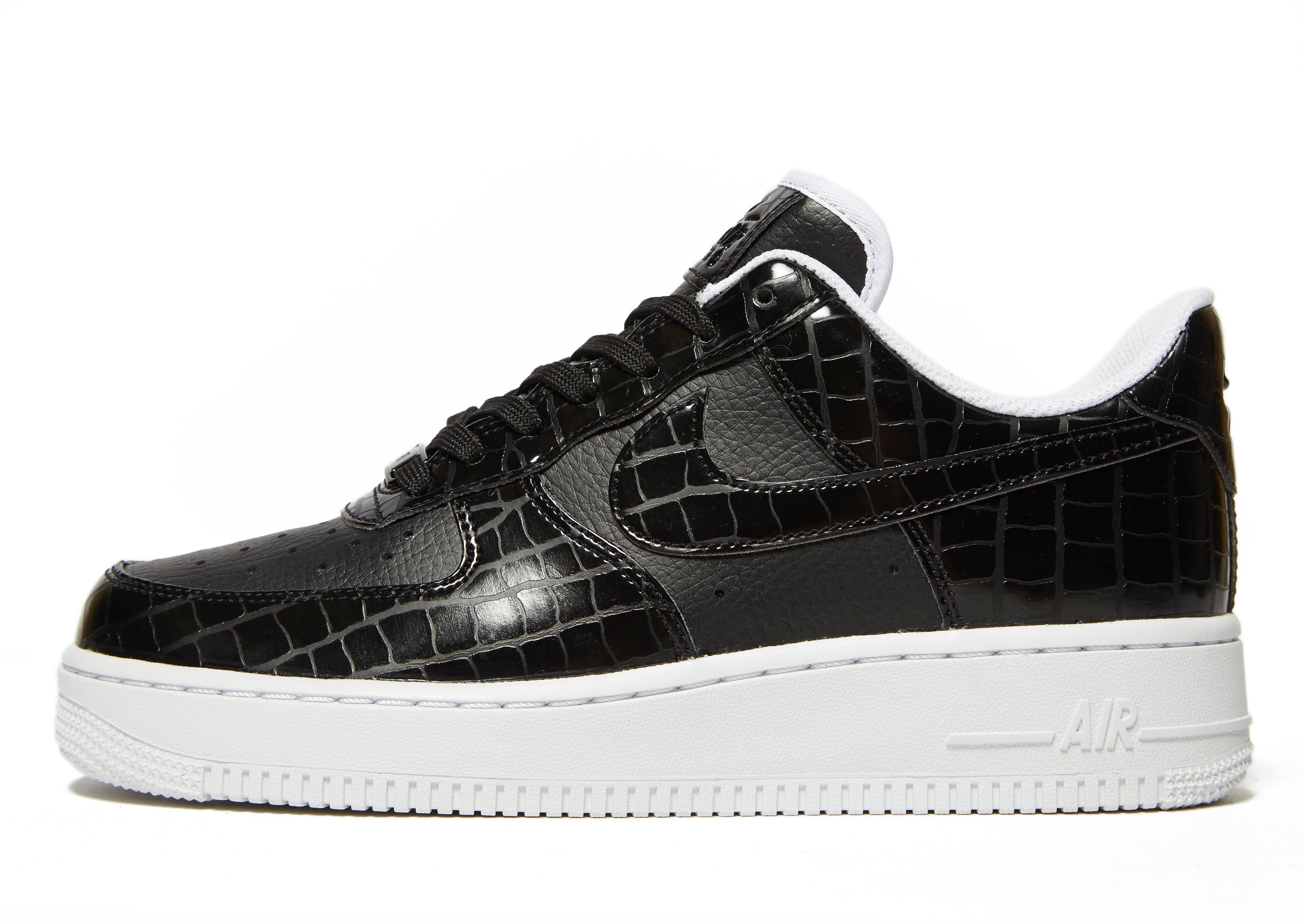 nike air force 1 low black and white reptile images