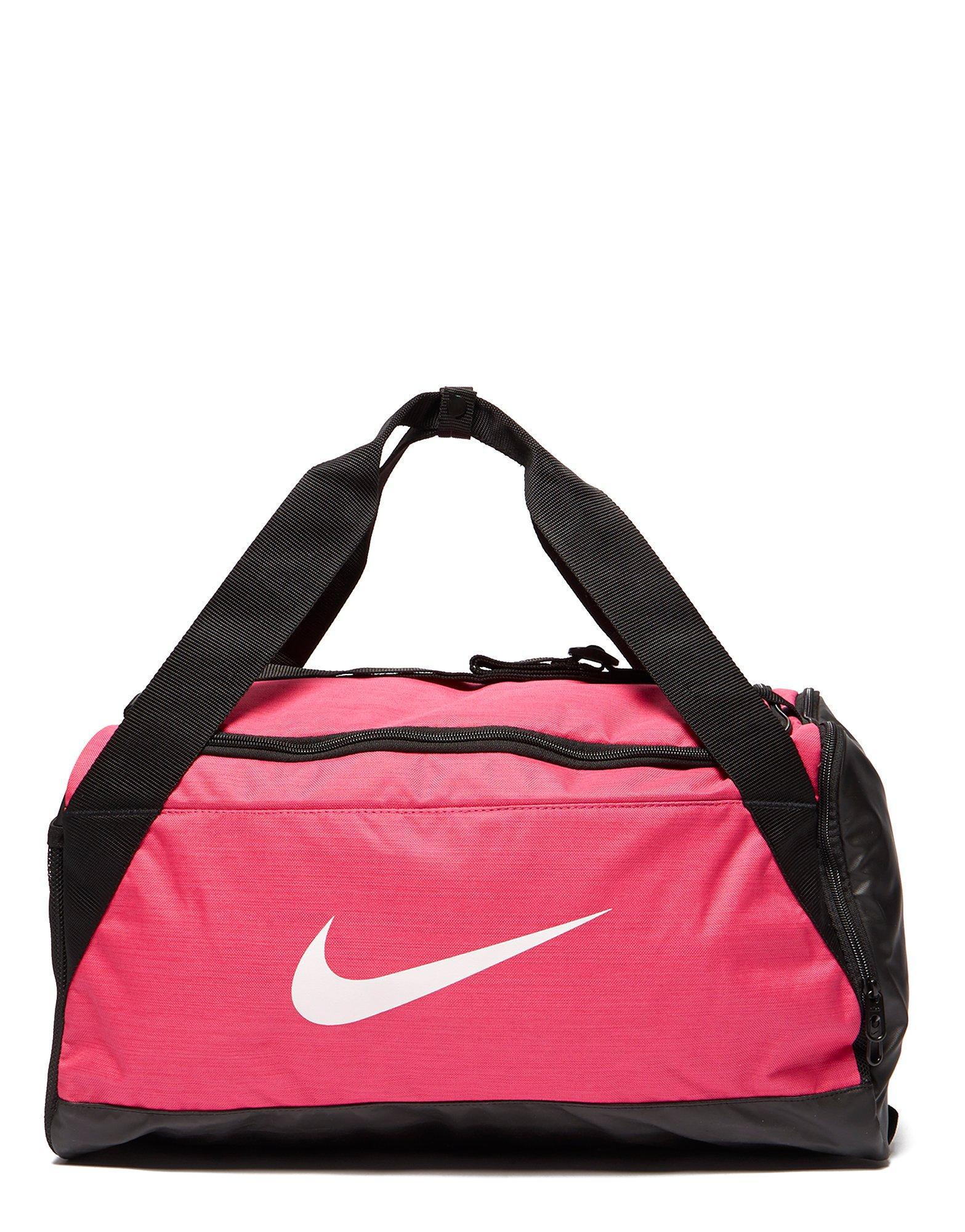 Lyst - Nike Brasilia Small Duffle Bag in Pink 582c48831a762