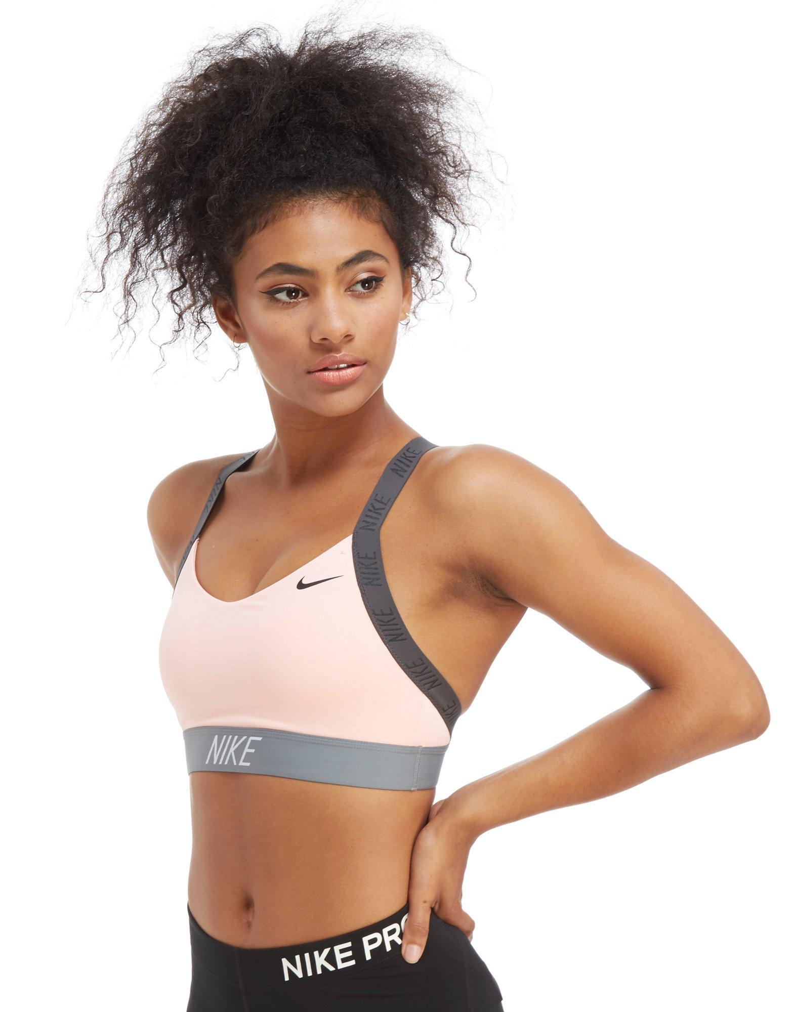 6a0e30b8bd Nike Training Indy Logo Sports Bra - Lyst