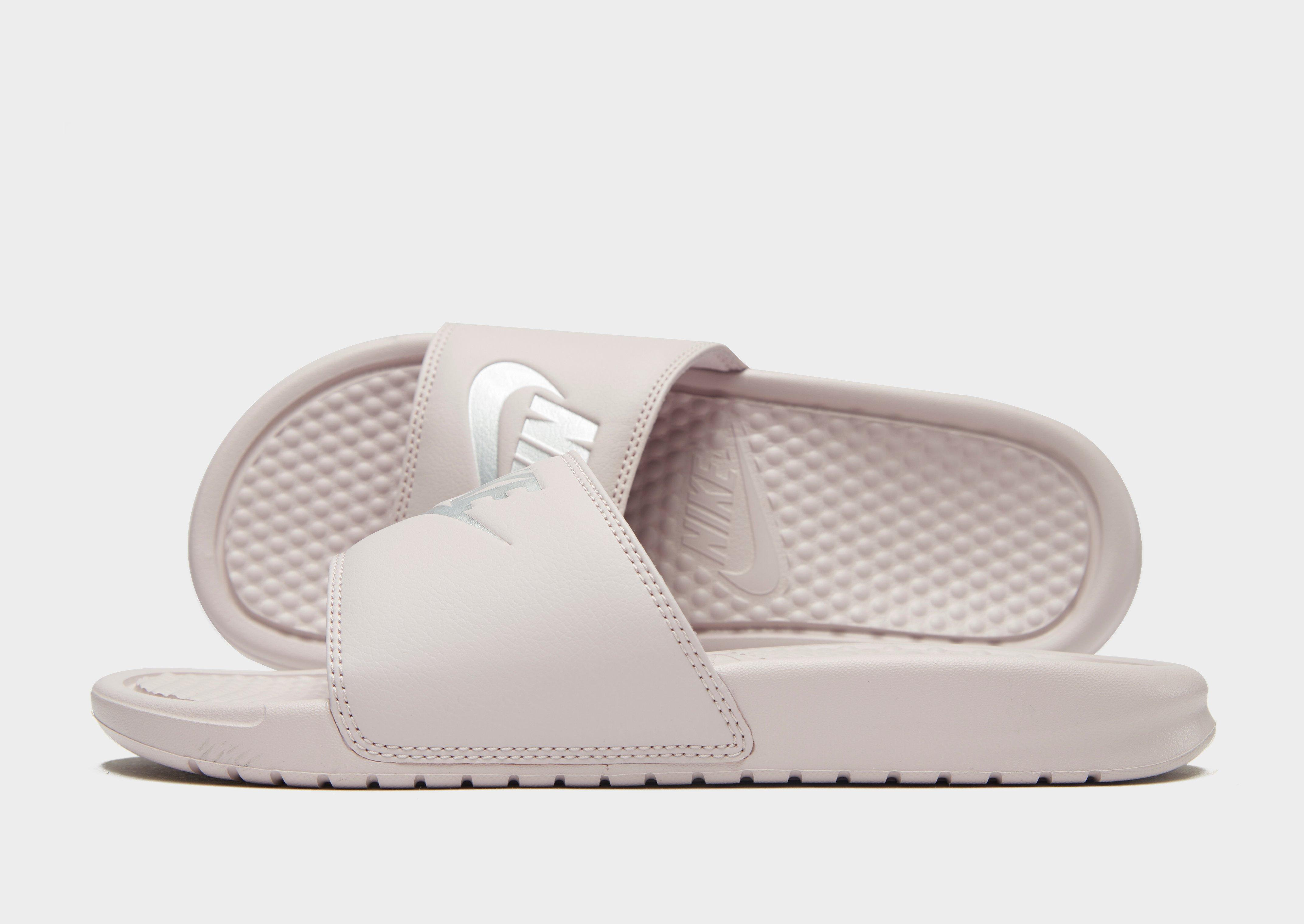 d4e09c63fc52e4 Nike. Women s Pink Benassi Just Do It Slides. £22 From JD Sports