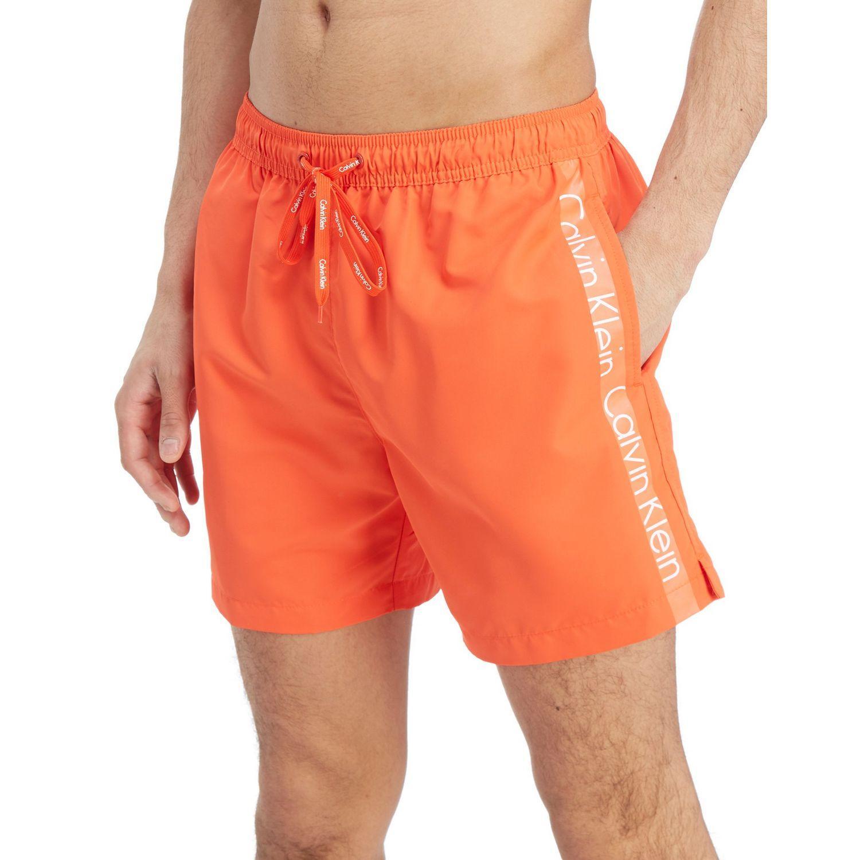 1f7a4922fa Calvin Klein Side Logo Swim Shorts in Orange for Men - Lyst