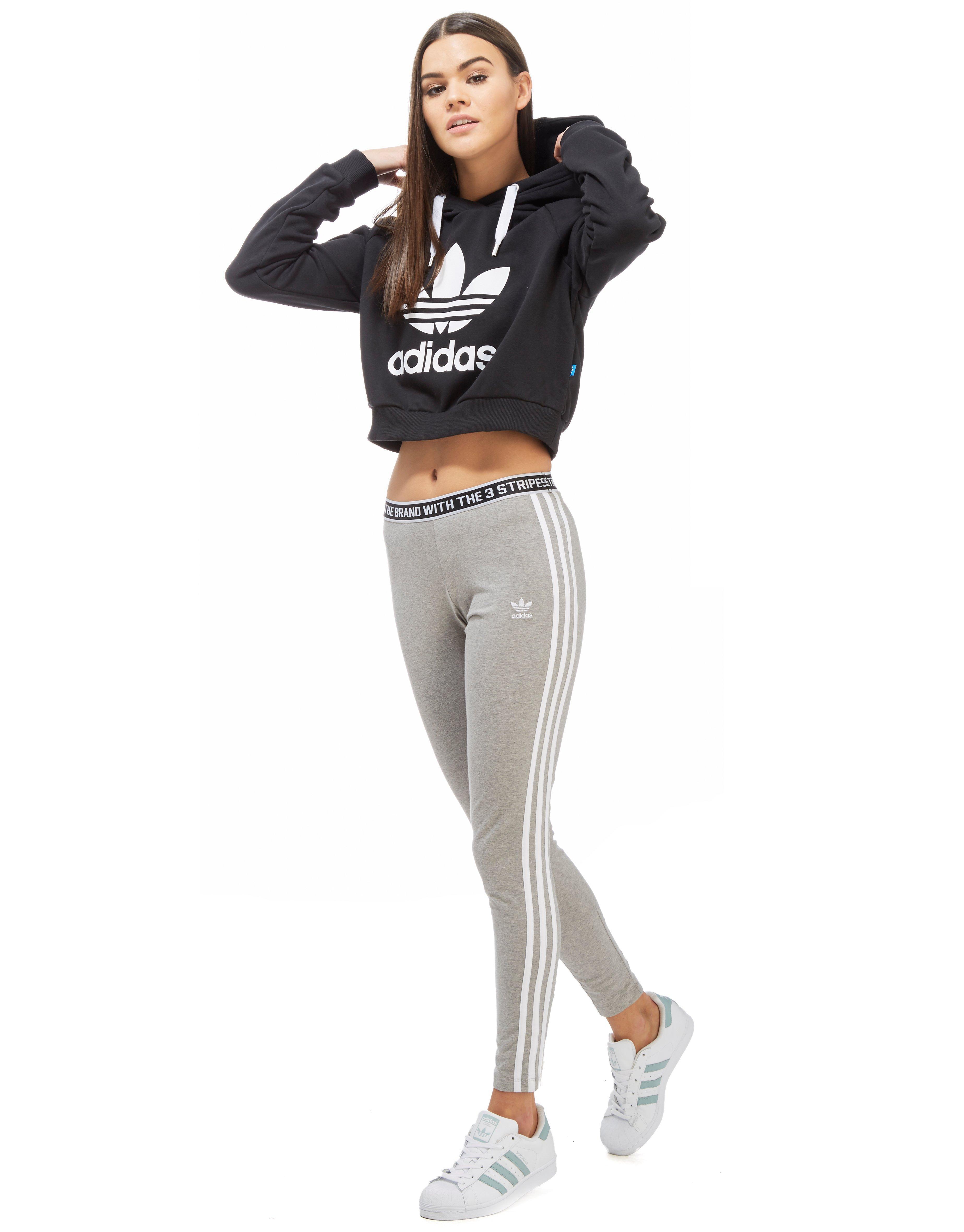buy online b4446 8c96a Lyst - adidas Originals Trefoil Crop Hoody in Black