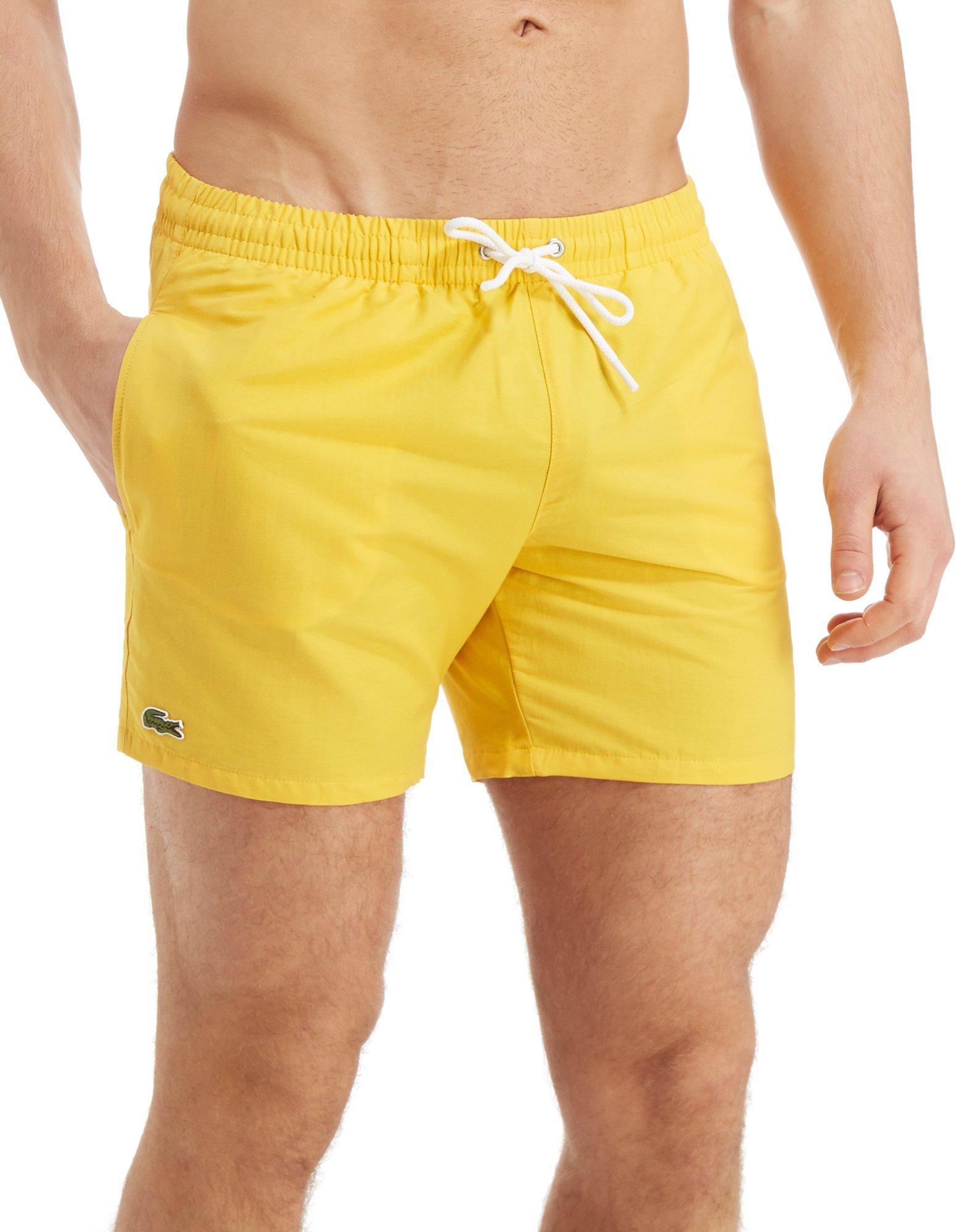 91415434ed Lacoste Core Swim Shorts in Yellow for Men - Lyst