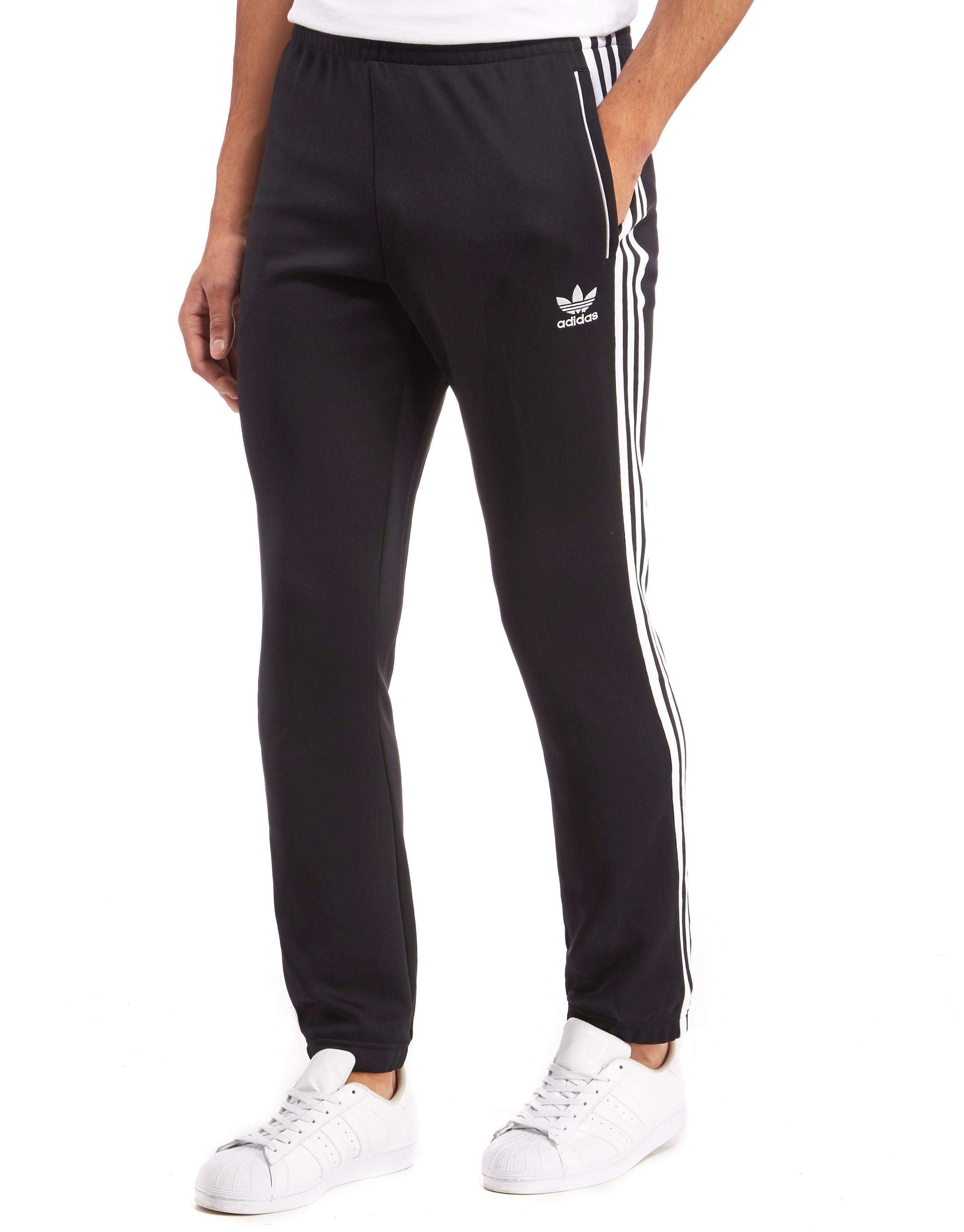 watch a5bd1 1e5ff adidas Originals 3-stripes Superstar Track Pants in Black for Men - Lyst