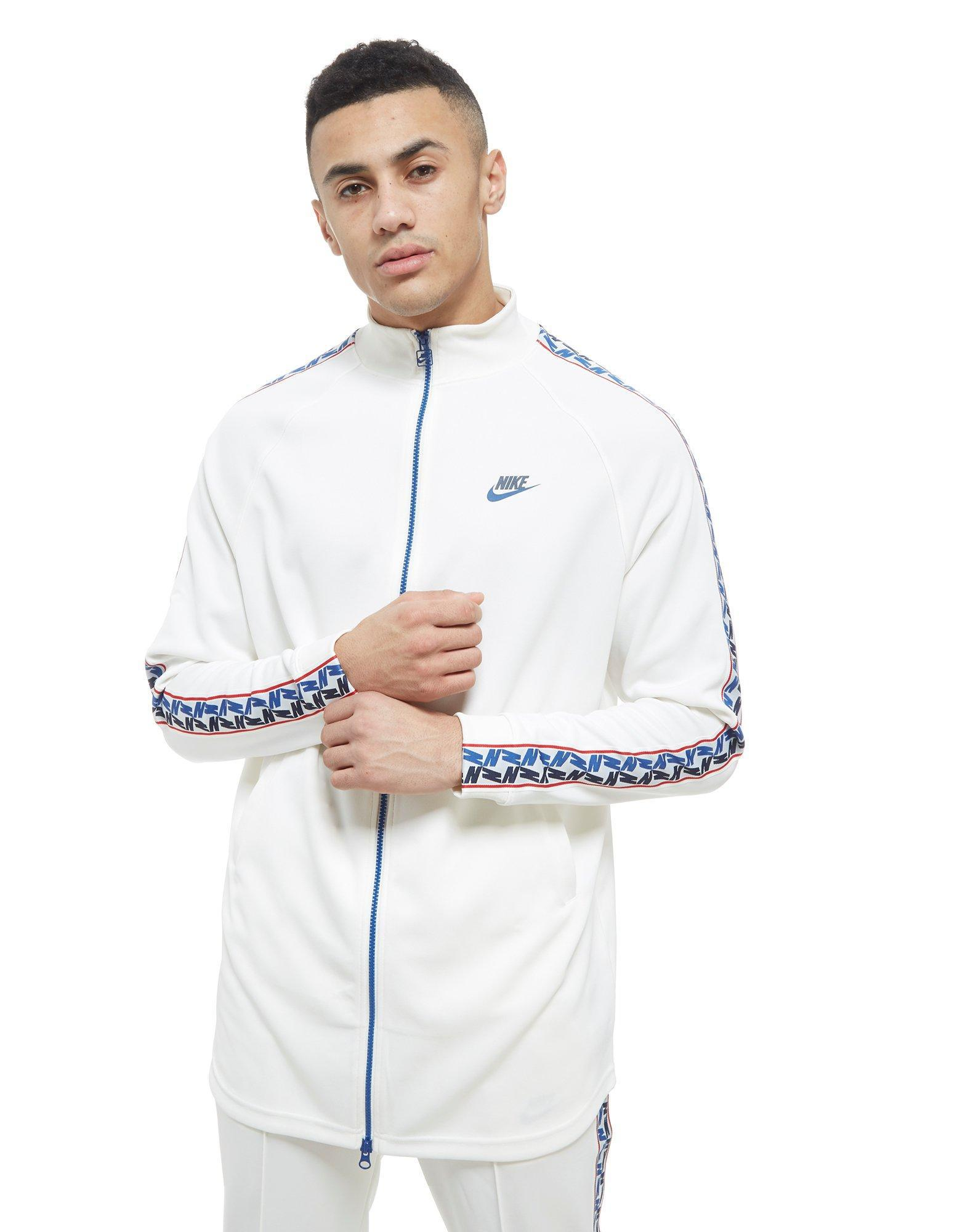 Nike. Men's White Taped Poly Track Top