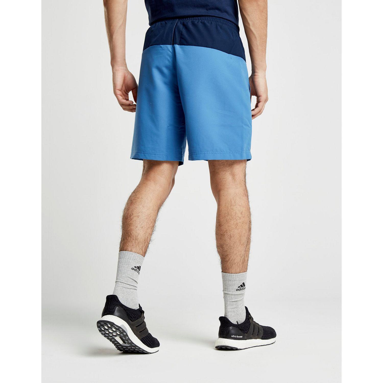 b5b9ce14ab Adidas - Blue Colourblock Swim Shorts for Men - Lyst. View fullscreen