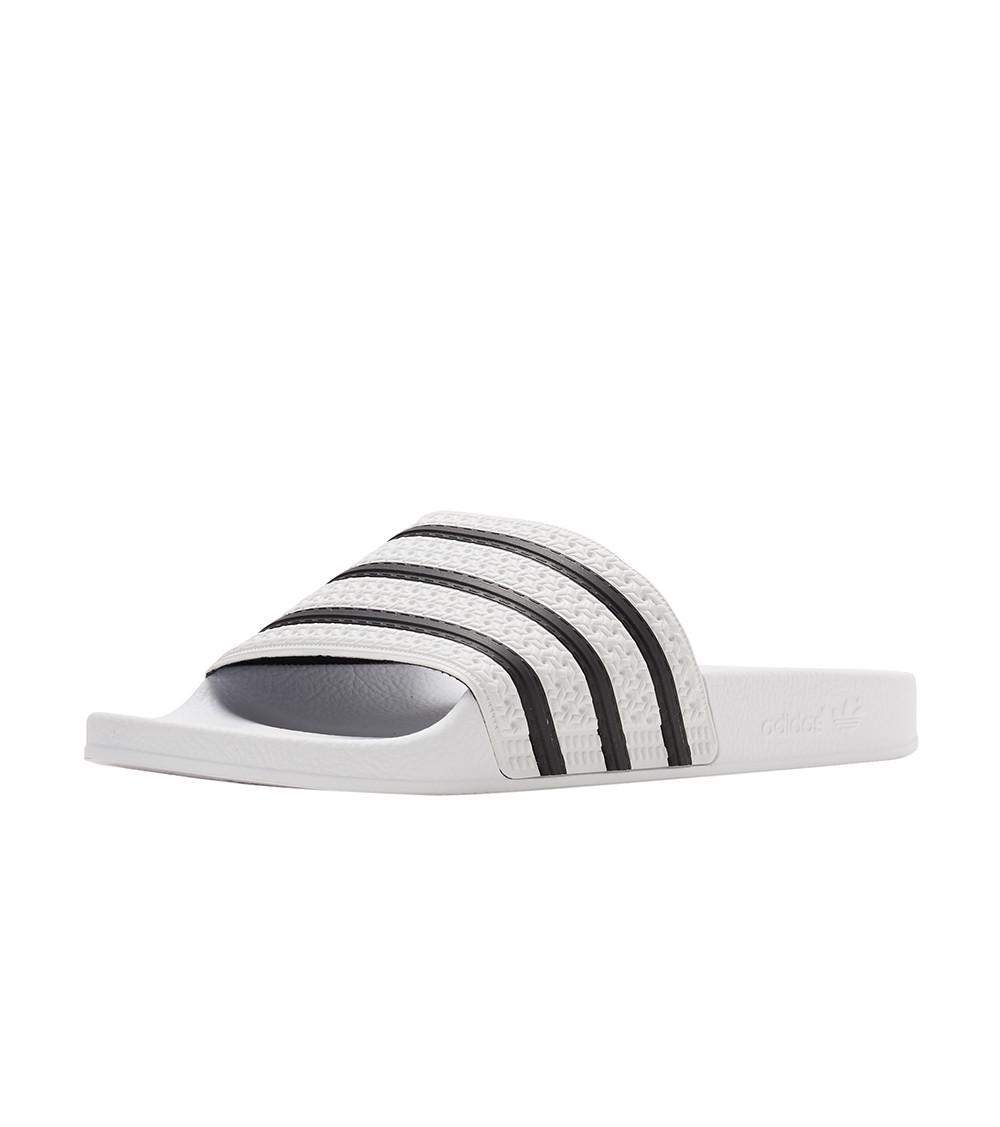5fe9a9624fb39a Adidas - White Adilette Slide for Men - Lyst. View fullscreen
