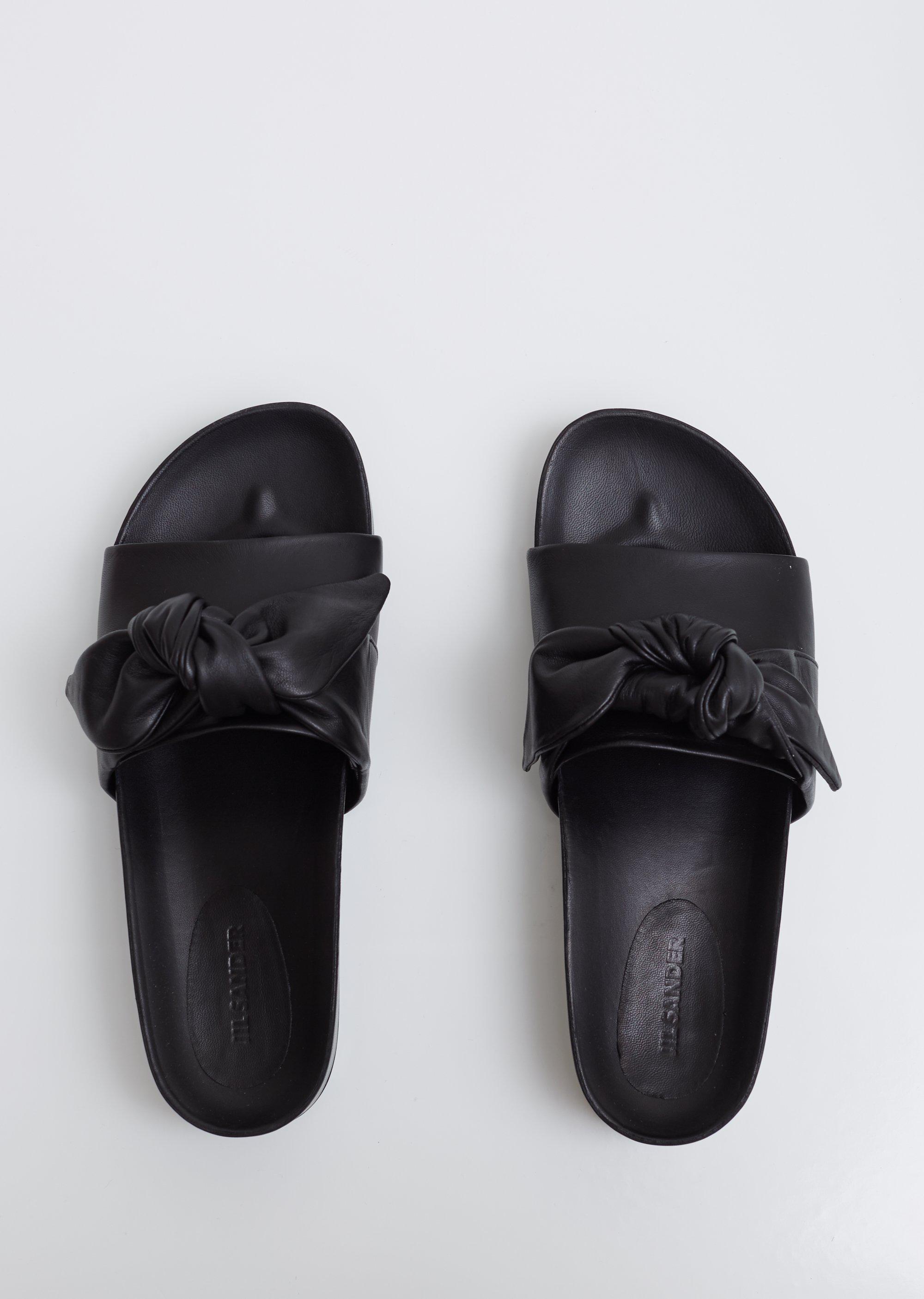 b74cb63a7b30 Lyst - Jil Sander Knotted Leather Slides in Black