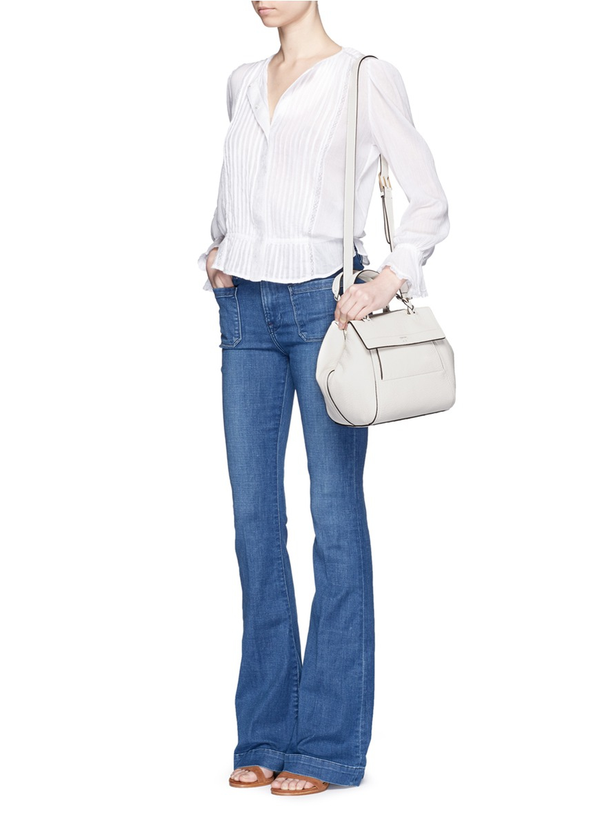 8fecb6e6431 Lyst - Tory Burch  half-moon  Small Leather Satchel in White