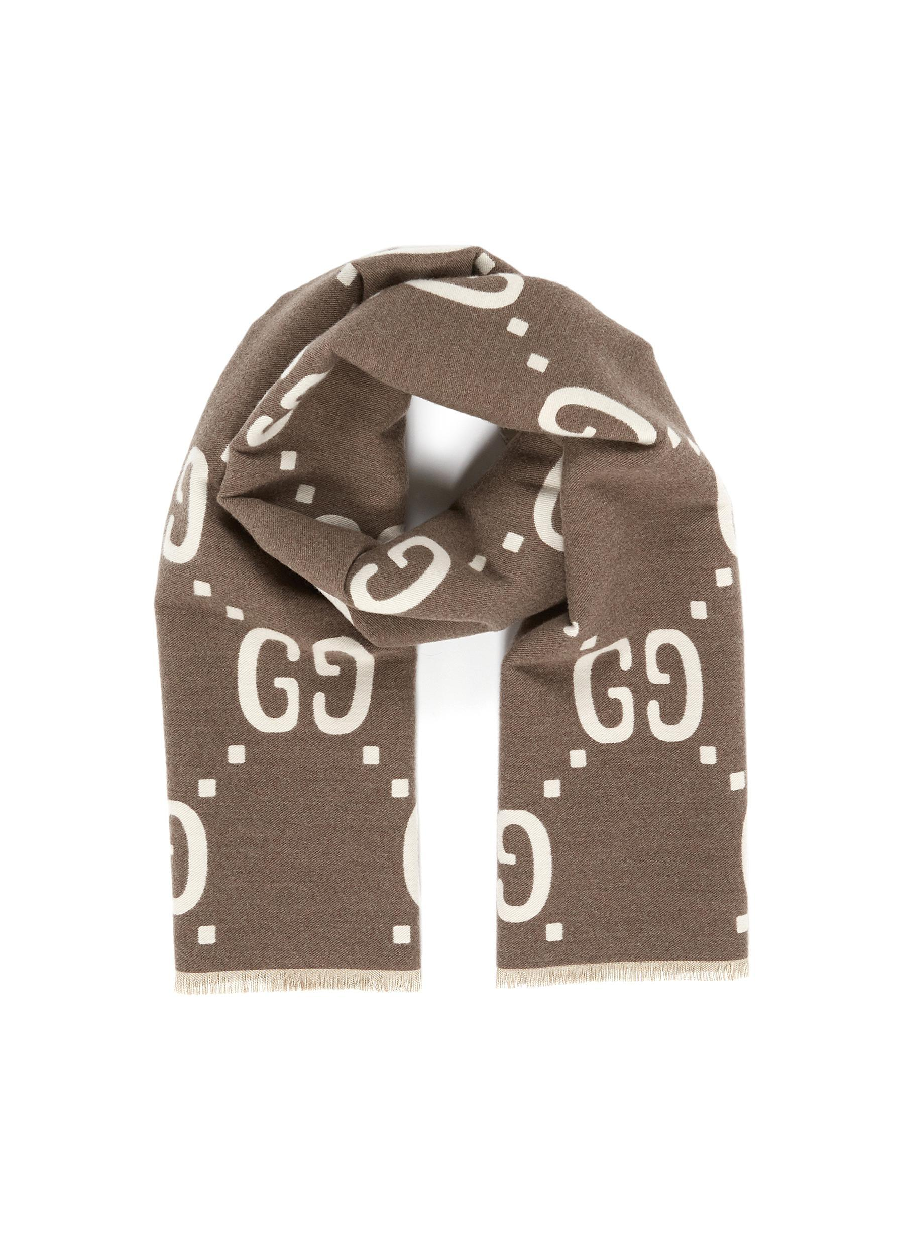 5e0617d0326 Gucci. Women s Reversible GG Logo Jacquard Wool-silk Scarf