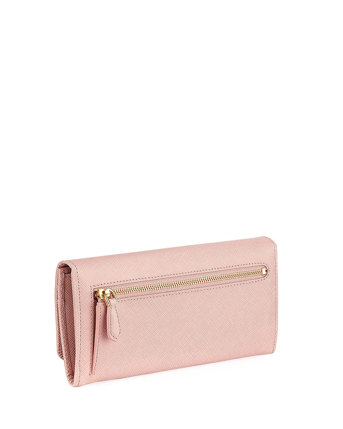 73c9168d5575 ... sale prada pink saffiano continental flap wallet with bow lyst. view  fullscreen d7524 ab291 ...