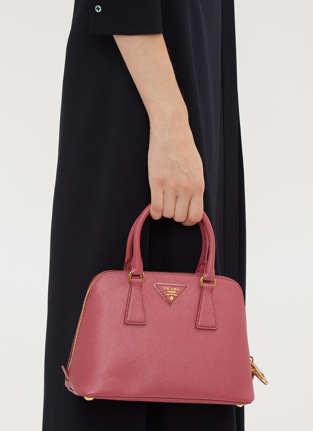 ff36db4abb6a Prada Round Saffiano Hand Bag In Pink in Pink - Lyst