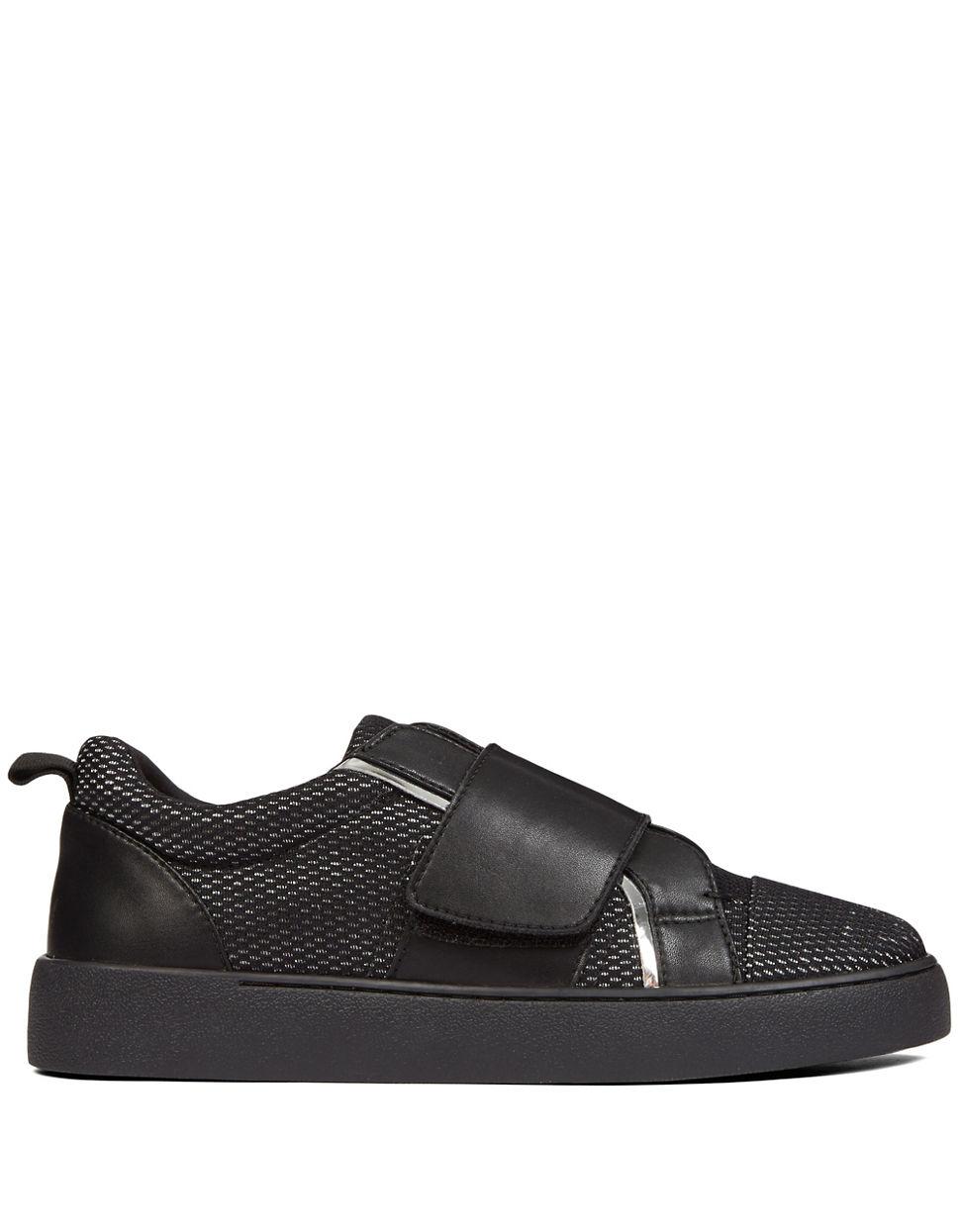 nine west leather slip on sneakers in black lyst