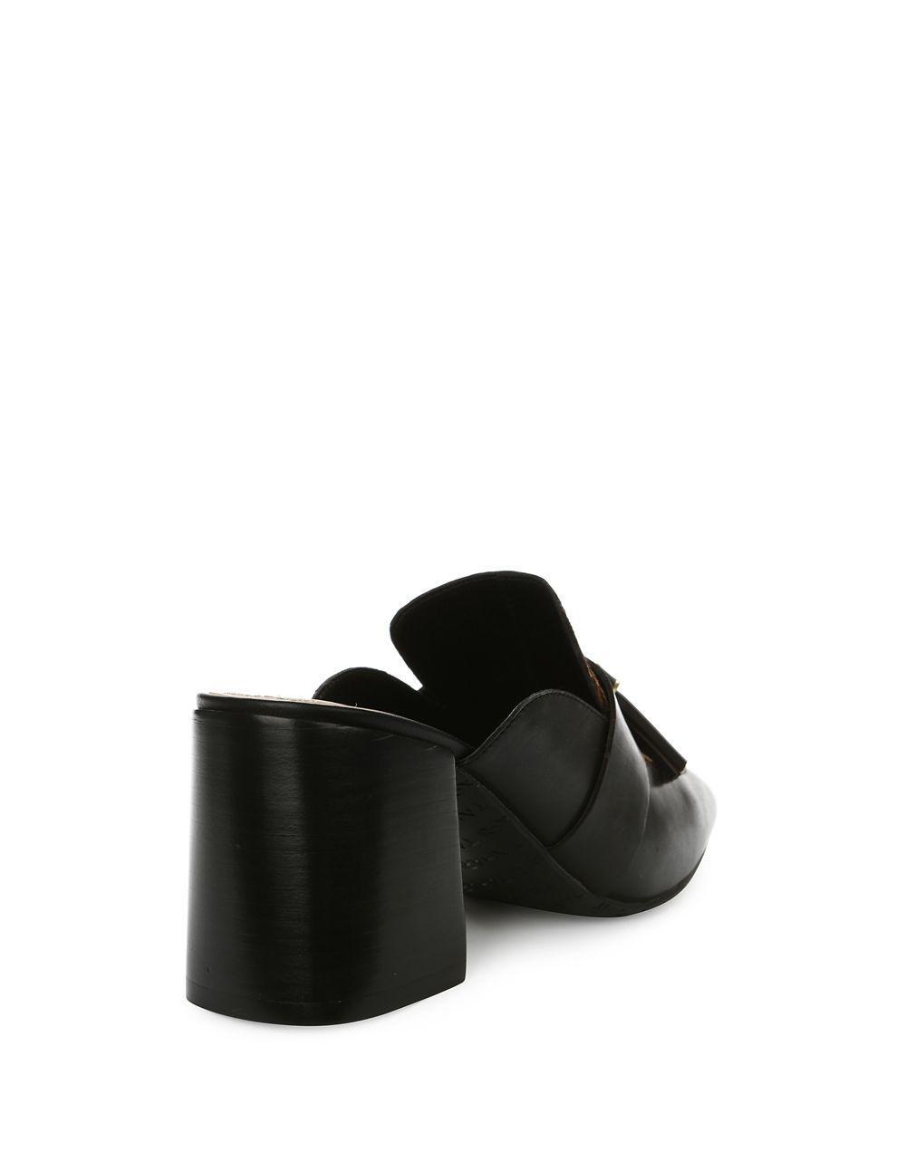 b43bfc089f96 Lyst - Tahari Porter Tassel Suede Calf Hair Mules in Black