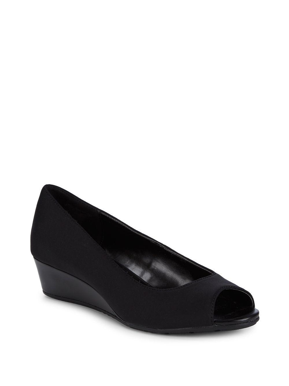 fa470e41a069 Lyst - Bandolino Candra Peep-toe Demi-wedge Pumps in Black