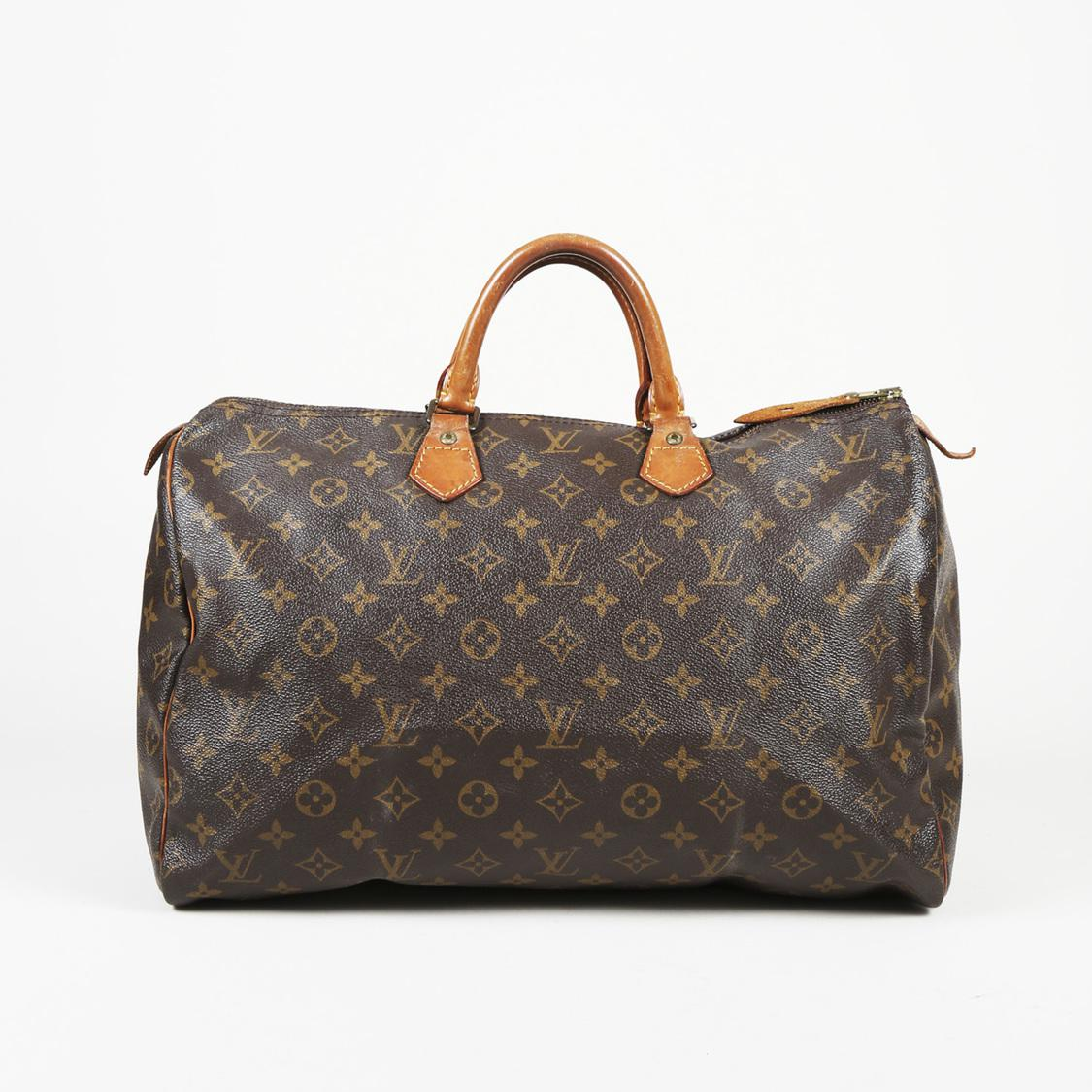 9c6eb47e22f6 Louis Vuitton. Women s Brown Vintage Monogram Coated Canvas