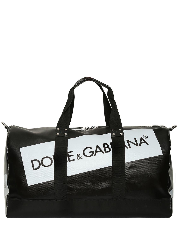 3996d5b5dd00 Dolce   Gabbana Logo Tape Coated Canvas Duffle Bag in Black for Men ...