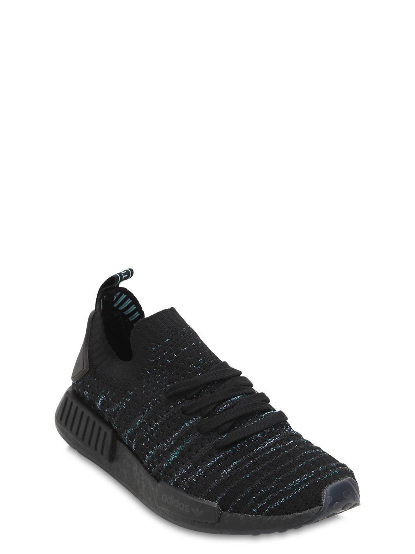 5be846ac1 adidas Originals Nmd R1 Parley Primeknit Sneakers in Black for Men - Lyst