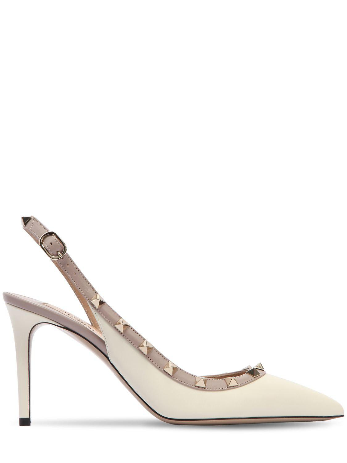 80c6c003aa0 Lyst - Valentino 85mm Rockstud Leather Slingback Pumps in White
