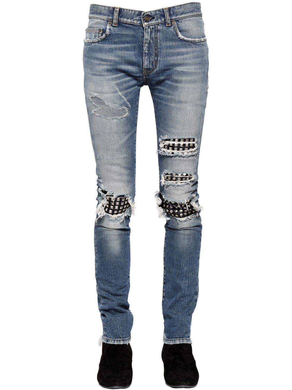 saint laurent 15cm studded leather patch denim jeans in. Black Bedroom Furniture Sets. Home Design Ideas
