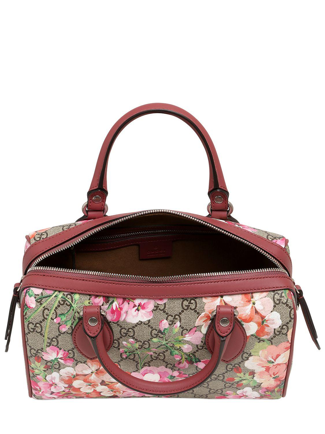 77c55226c85936 Lyst - Gucci Blooms Print Gg Supreme Top Handle Bag in Pink