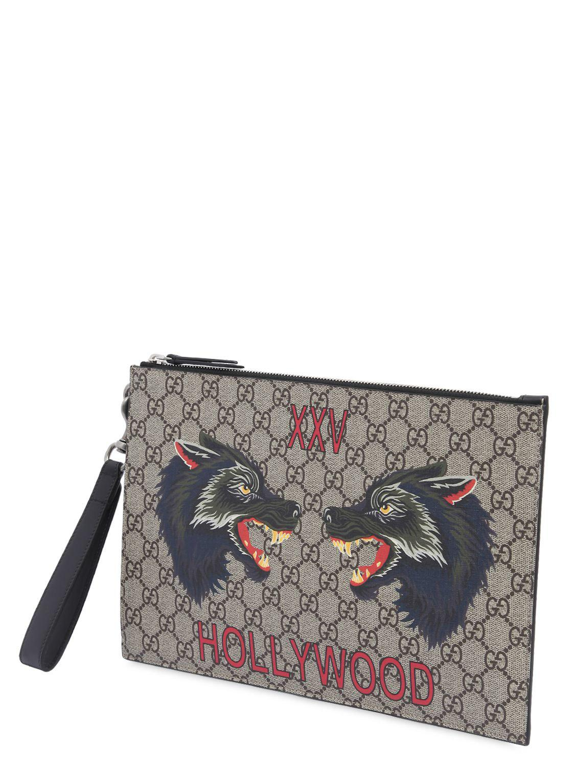 25720c5f19fb Gucci Wolves Printed Gg Supreme Pouch in Natural - Lyst