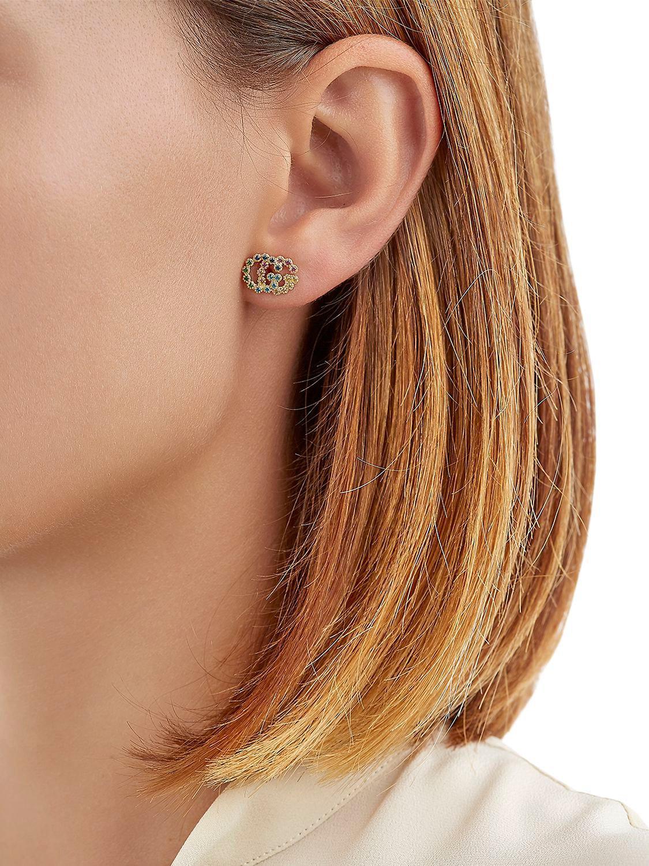 058d71f8417 Lyst - Gucci Running G Stud Earrings in Metallic