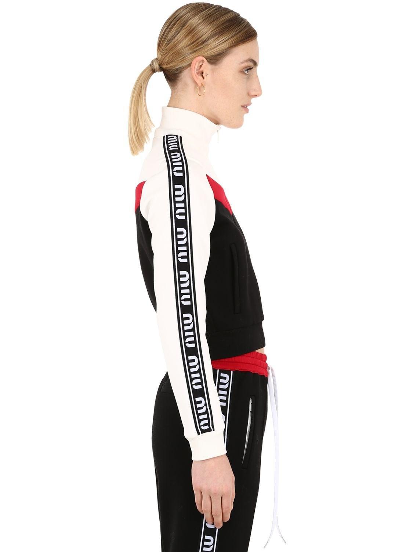 71ef79c6647c Lyst - Miu Miu Zip-up Cotton Track Jacket W  Logo Bands - Save 29%