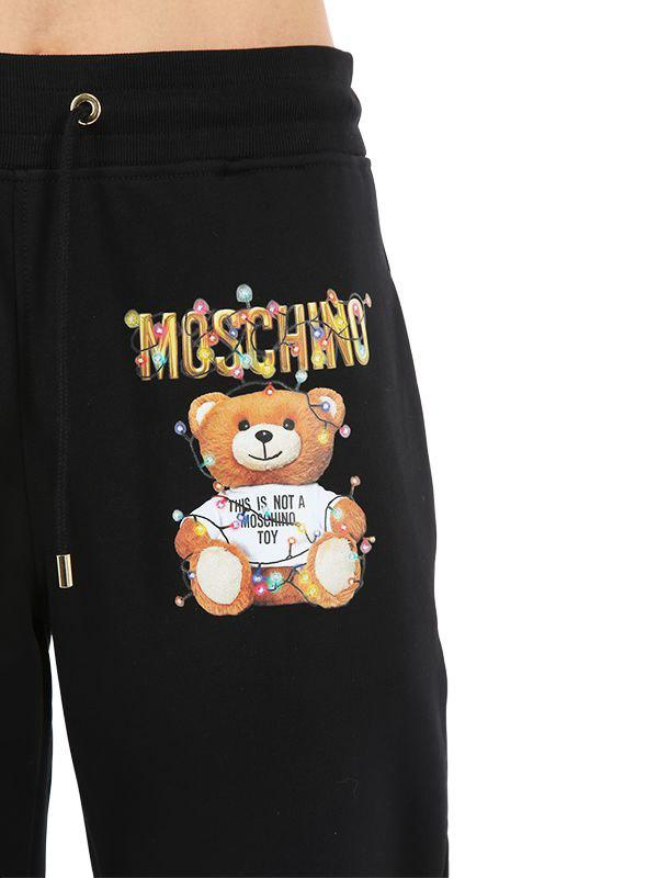 c01a148c4 Lyst - Moschino Logo Printed Cotton Jersey Sweatpants in Black