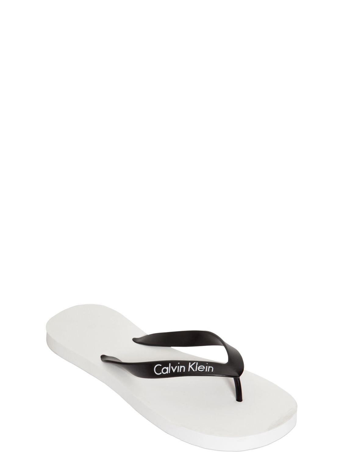 0bff9eba00da Lyst - Calvin Klein Logo Rubber Flip Flops in Black for Men