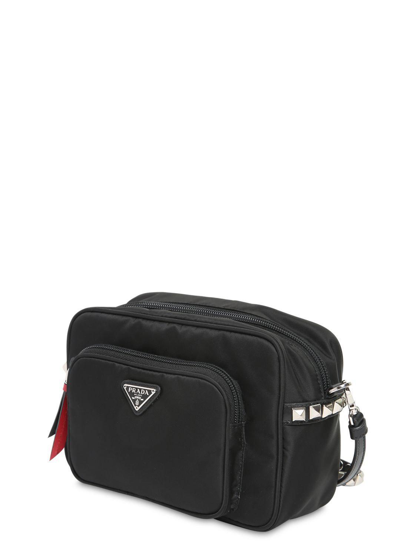 7b79bc4eff6326 Prada New Vela Nylon Bucket Bag W/ Studs in Black - Lyst